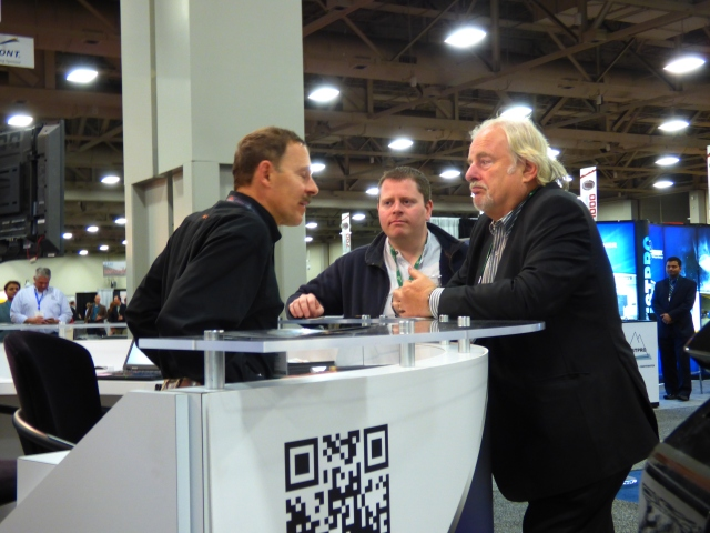 At SME, Mintec's Frank Olivieri (left) fields questions from International Mining's John Chadwick (right) and Paul Moore.